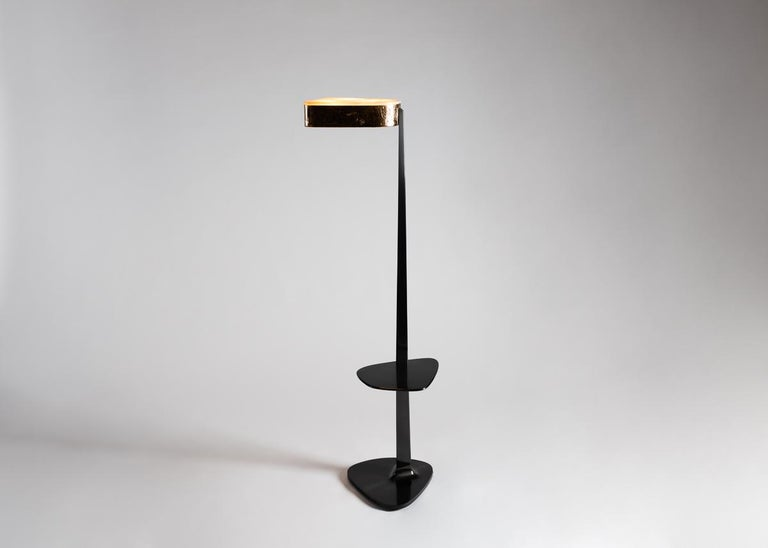 Pinocchio is a floor lamp cut from the same mold as Achille Salvagni's popular spider chandelier. The piece has a sheer, patinated bronze body, a hand hammered bronze head, and a shade of lush and creamy (though uniquely veined) onyx.