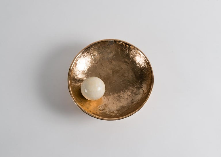 Saturn, Achille Salvagni's cast bronze concave sconce, is illuminated from within by a celestial onyx sphere reminiscent of a satellite in orbit.  Bulb 20W T3 halogen clear G4 Bi-pin bulb 12V