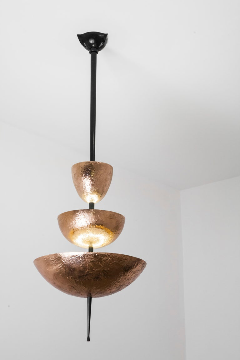 Achille Salvagni Simposio chandelier 2017 Cast bronze chandelier with a natural finish and burnished bronze stem. This chandelier is named after Plato's Symposium, a praise to Eros, God of Love and Desire, and its unique texture is inspired by an