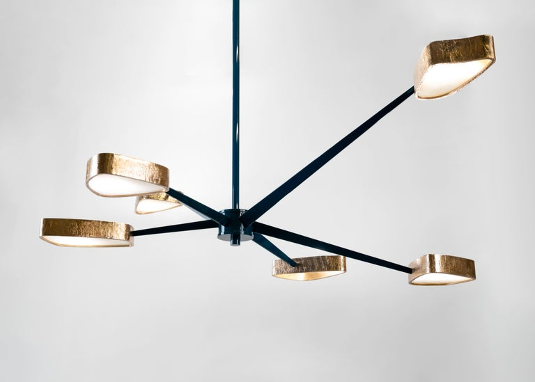 Spider's six lacquered bronze arms, accented at their ends with shades of polished bronze and onyx, reach out and over one another, creating an unmatched visual dynamism and bathing all below in a warm, soft light.  Bulb: six 25 watt bulbs.