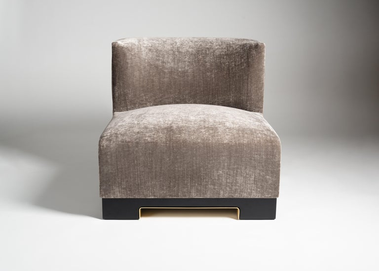 Vittoria is a plush, armless club chair by Italian designer Achille Salvagni. Its lacquer base is available in a variety of colors and accented with a rim of polished bronze. Upholstery is customizable.  Edition of 40.
