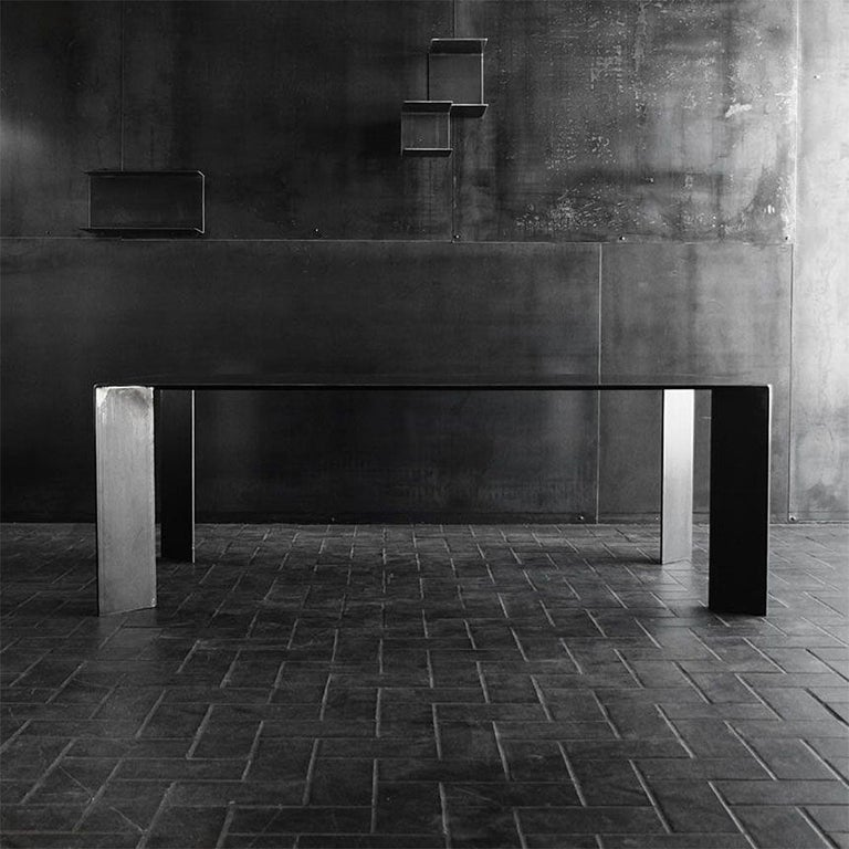Raw steel dining table, black-dark finish, French manufacture, colorless varnished. Chairs not included. Available in: L 200 x D 100 x H 75 cm, price: € 4,500.00 L 220 x D 100 x H 75 cm, price: € 4,900.00 L 250 x D 100 x H 75 cm, price: €