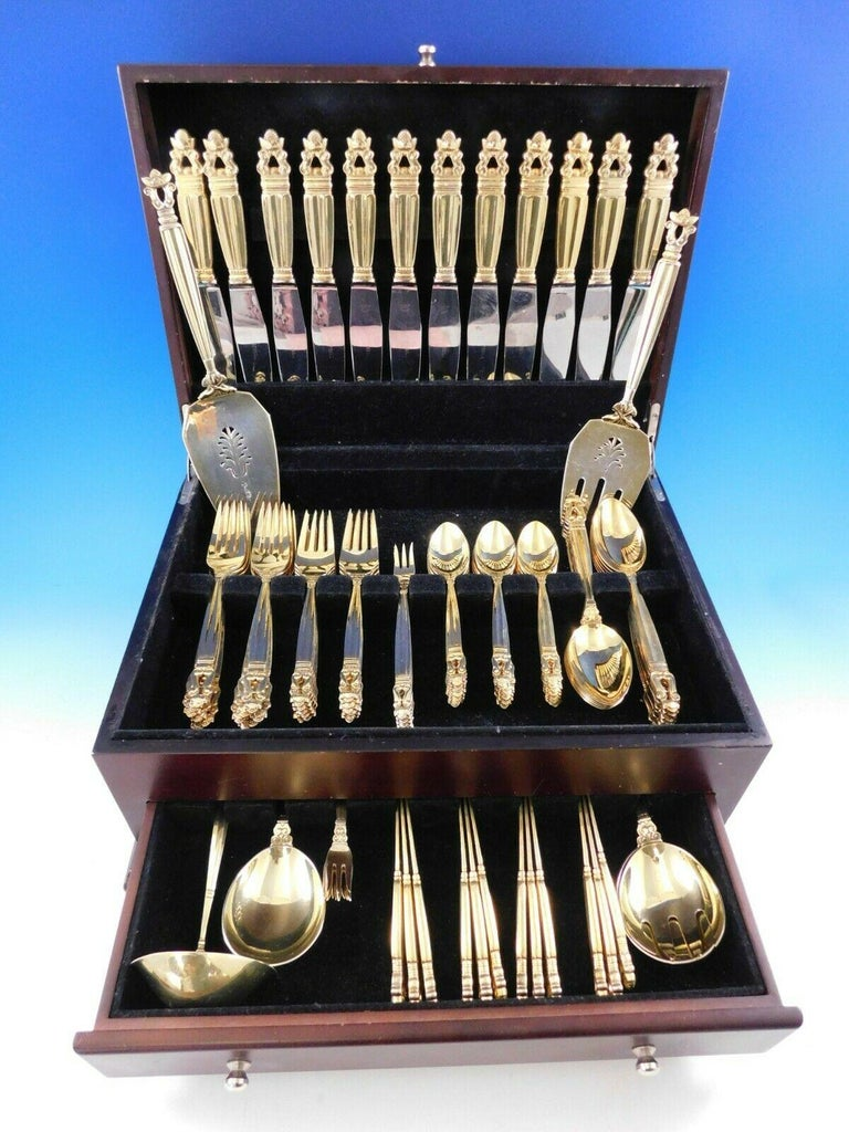 Exceptional dinner size vermeil (lightly gold-washed) acorn by Georg Jensen sterling silver flatware set, 102 pieces. This set includes:  12 dinner knives, 9