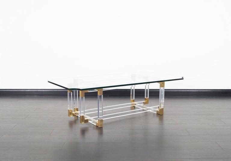 This spectacular acrylic and brass coffee table was designed by Charles Hollis Jones for part of his