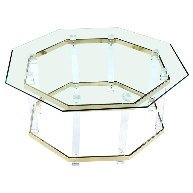 Vintage 1980s Charles Hollis Jones style Lucite and brass coffee table with beveled hexagon glass top. The geometric beveled glass top creates a silhouette mimicking the dynamic angles and form of the table base. Vertical acrylic architectural