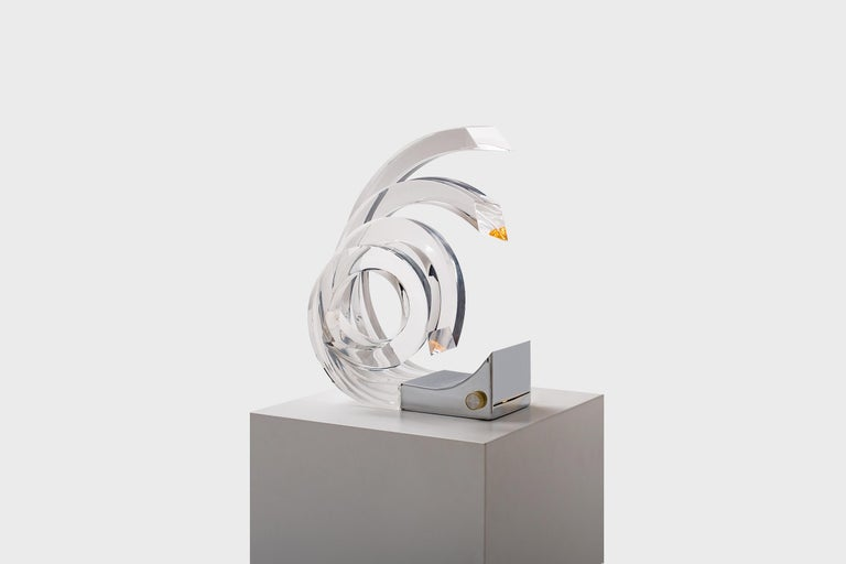 Rare acrylic table lamp by Gaetano Missaglia, Italy, circa 1965. Spectacular radical design composed of thick Lucite curls on a chromed metal base. The light comes from inside the chromed base and is beautifully 'transported' true the acrylic glass.