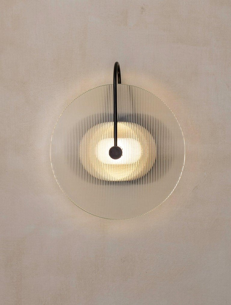 """A scaled version of our Aperture Sconce with glass diffuser. Under 4"""" in depth to meet standards of the Americans with Disabilities Act for commercial walkways."""