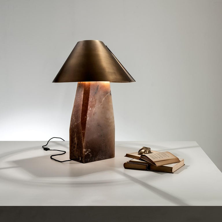 This astonishing Ada table lamp by Cesare Arosio combines ancient and modern elements in a design of timeless elegance and visual allure. The sculptural alabaster base supports an exquisite satin-burnished brass coolie lampshade. A polyhedral form
