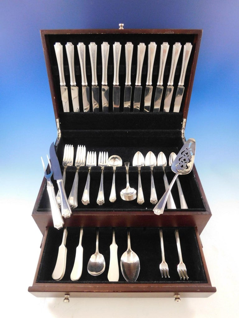 Monumental dinner size Adam by National circa 1917 sterling silver flatware set of 102 pieces. This set includes:  12 dinner size knives, 9 1/2