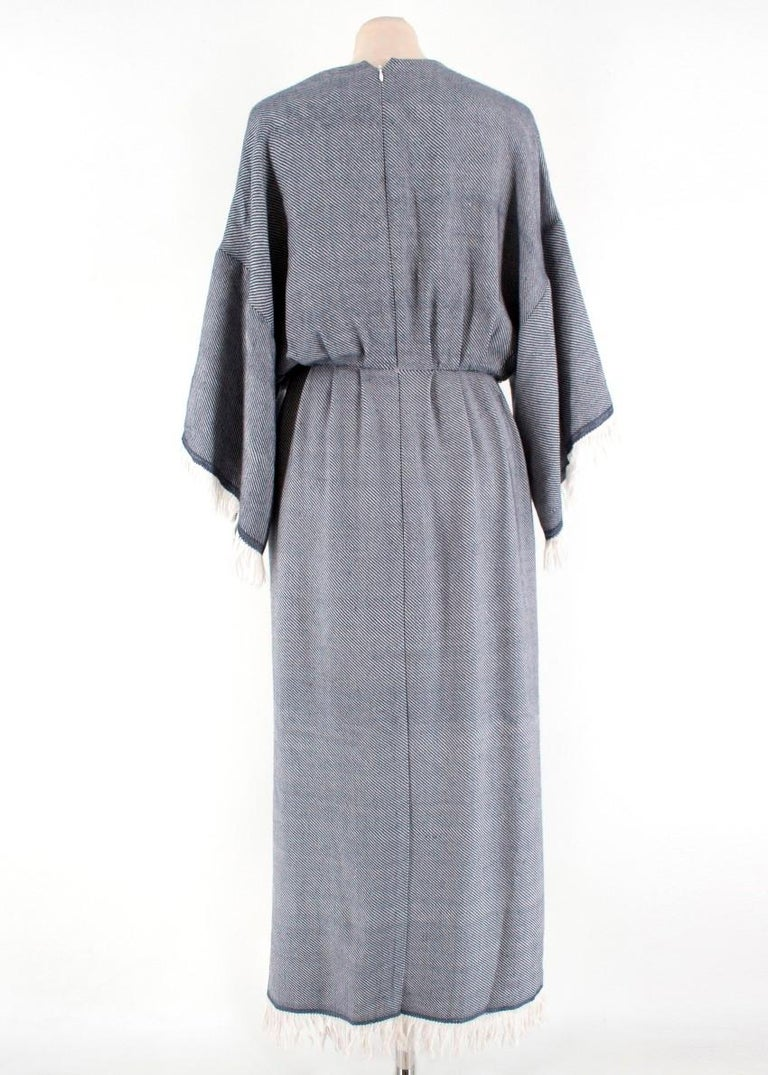 Adam Lippes Fringed Wool-Blend Wrap Dress  *Current Season*  - Grey and ivory stripe intarsia - V-neckline - 3/4-length wide sleeves - Dropped shoulder seams - Wrap design - Gathered waist - In-seam side slip pockets - Ivory fringed cuffs and hem -