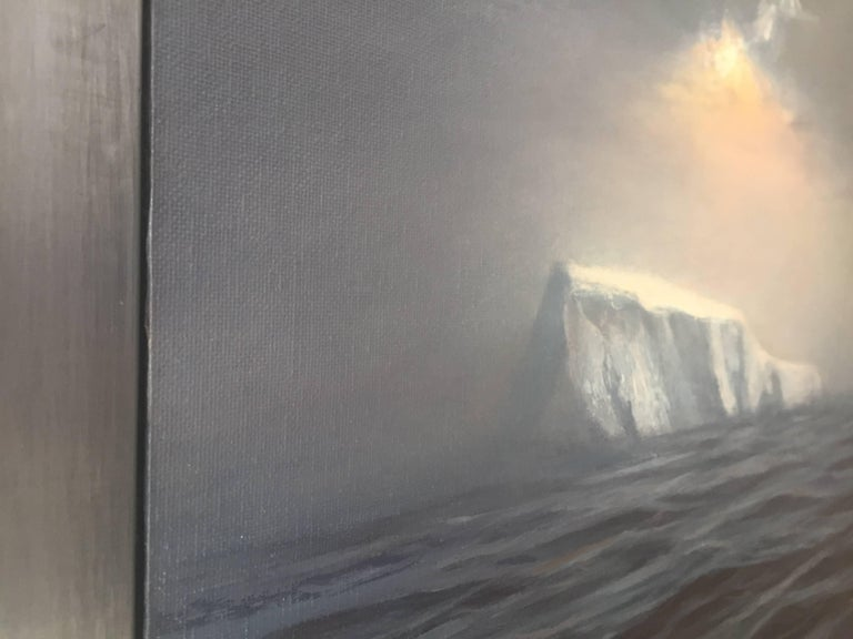An oil painting encased in a lead frame. An iceberg peaks out of the dark, vast ocean. Strong geometric forms strike with weight against the fluidity of water, and glisten in reflection of the glowing golden skylight above. Light peeks out from an
