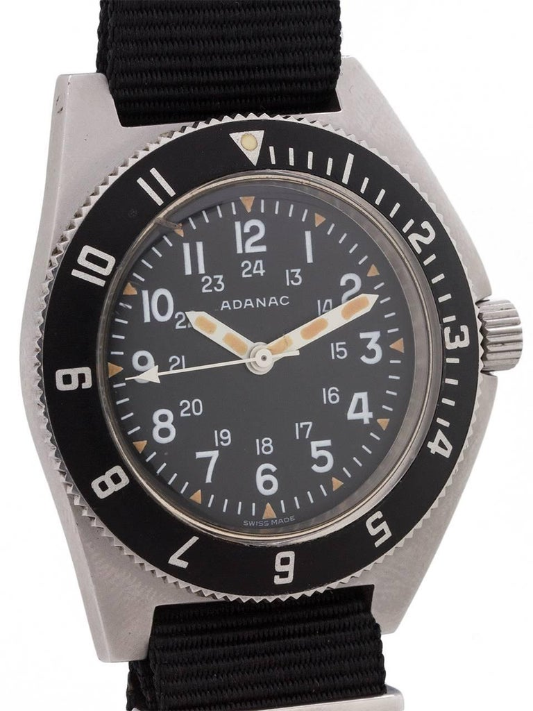 Adanac (Canada spelled backward) military issued model to the USAF and Canadian armed forces circa 1986. Featuring large 43.8 X 47.8 rugged brushed finish stainless steel case with sloped and integrated rotating elapsed time bezel, and asymmetrical
