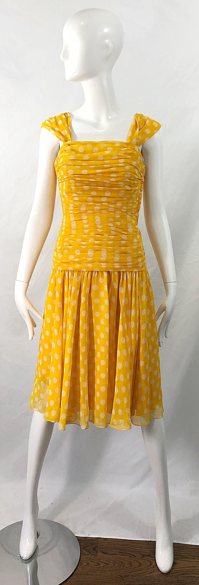 Flirty 1980s ADELE SIMPSON yellow and white silk chiffon polka dot dress ! Features a boned ruched bodice, with a slightly dropped waist. Multiple layers of chiffon on the skirt. Fully lined. Hidden zipper up the side with hook-and-eye closure.