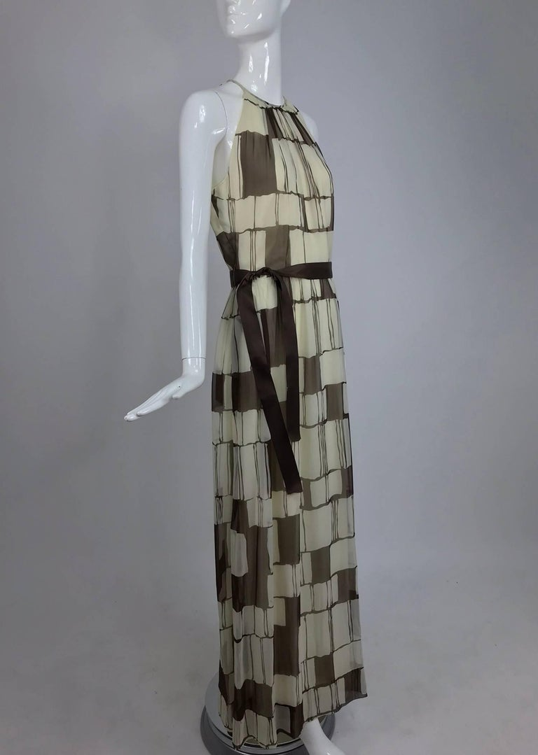 Adele Simpson brown and white silk chiffon halter maxi dress from the 1970s...Brown and white colour blocks create this bold pattern fabric...Halter neck dress shows lots of bare shoulder, it is has deep arm openings...Seamed waist with lightly