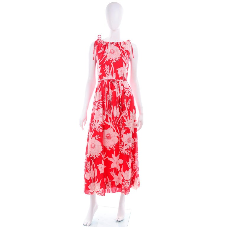 This bold red floral print vintage Adele Simpson sleeveless dress and cape ensemble was purchased at Harzfeld's Department Store in Kansas City in the 1970's. abel sewn in the bottom liner. This red and white floral printed cotton dress is lined in