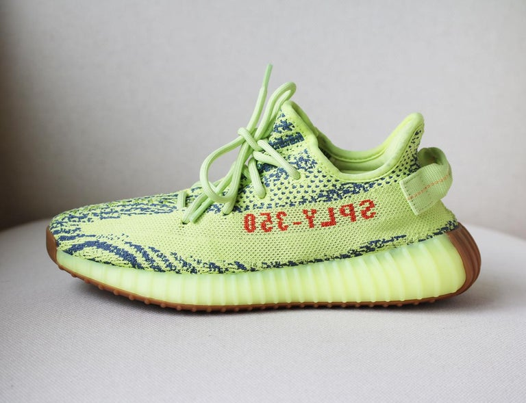 """Topping Yeezy'srarity chart, the """"Semi-Frozen Yellow"""" Boost 350 v2 makes a long-awaited return to the line-up, dressed in 2017's hi-vis hues. Re-released in all its fluorescent glory, the ultra-neon Primeknit is engineered with the signature"""