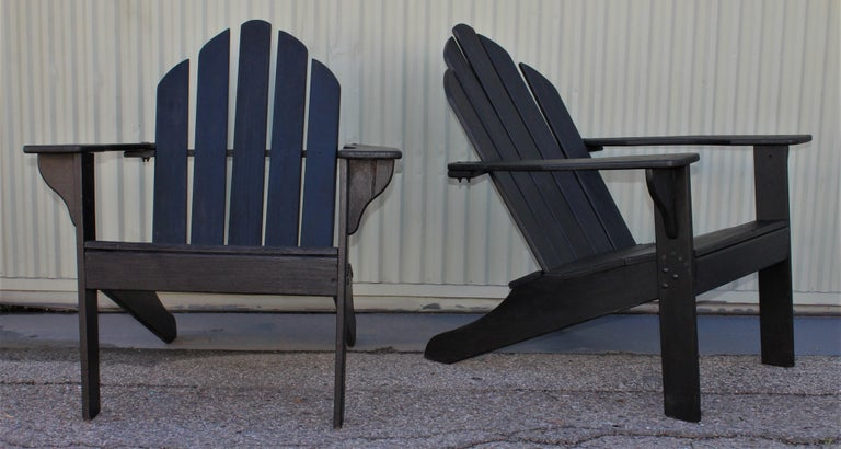 These folky Adirondack lawn or porch chairs are in good condition and are in black paint with a coat of all weather protector painted surface. Great also for a beach house.