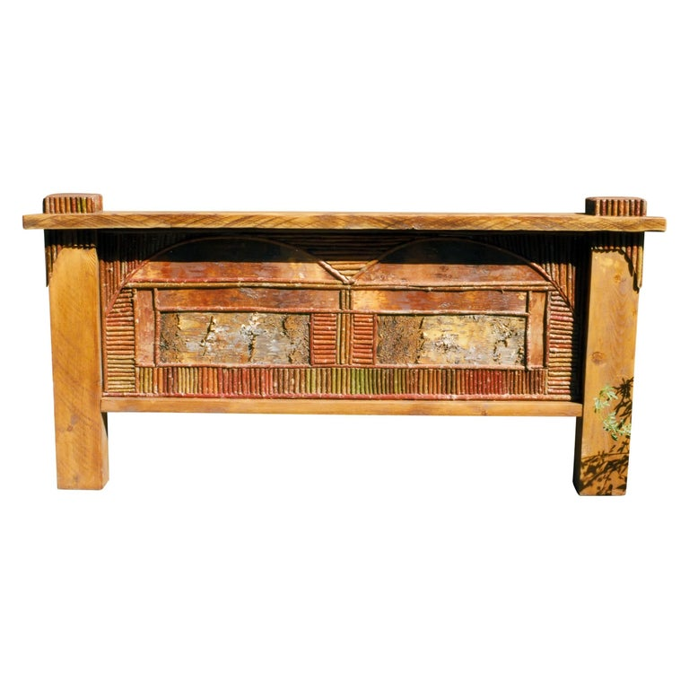 Rough hewn barn beam style, with birch bark and twig work, headboard, and iron rails; with decorated cover. Takes 6 1/2' x 6 1/2' mattress. With original artwork - moose, elk, trout, custom, or with birch bark and twig work. Each is