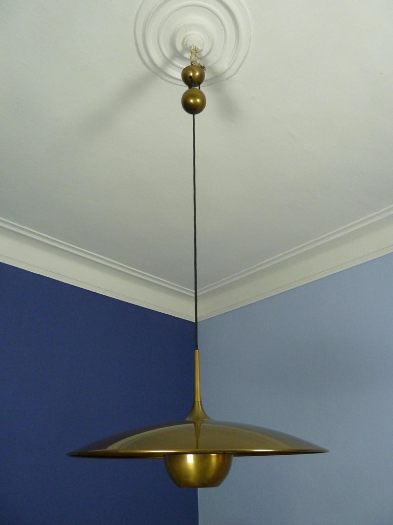 Mid-Century Modern Adjustable Brass Pendant Onos55 by Florian Schulz with a Central Counterweight For Sale