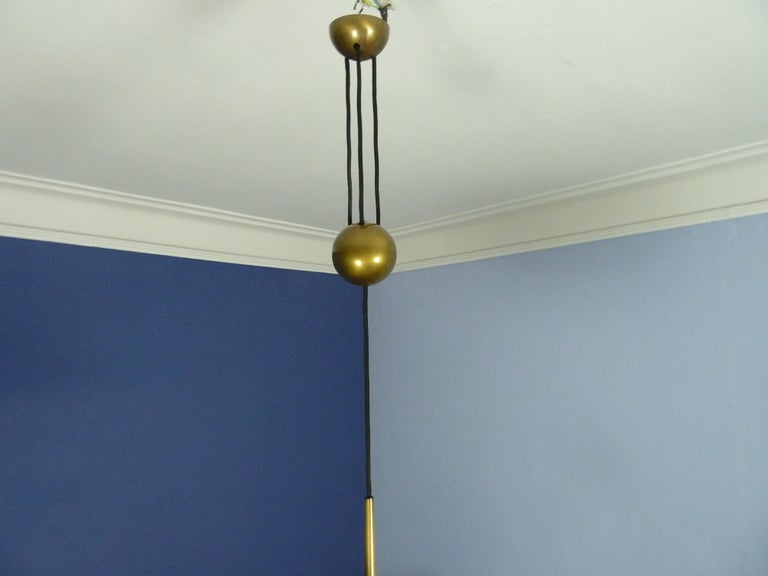 Adjustable Brass Pendant Onos55 by Florian Schulz with a Central Counterweight For Sale 1