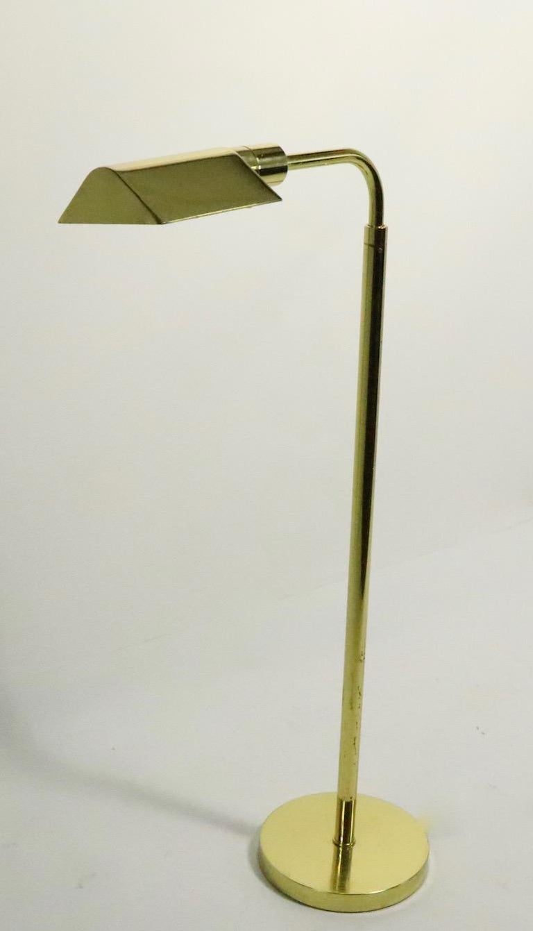Adjustable brass pharmacy lamp by JPF Mendizabal for Industria Argentinia this floor lamp is adjustable in height (Highest position 52.5, lowest position 39 inches). Original, clean and working condition, accepts standard size screw in bulb. Very