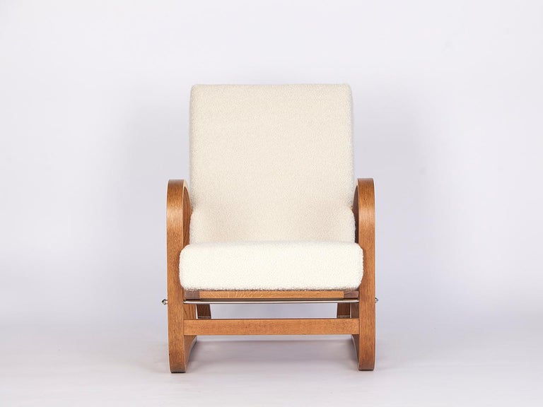 This H-70 armchair was designed by Jindrich Halabala and produced by Spojene UP zavody, circa 1930. The backrest and seat can be put in three different positions. The wooden parts restored. Covered with an Italian fabric made of soft wool and alpaca