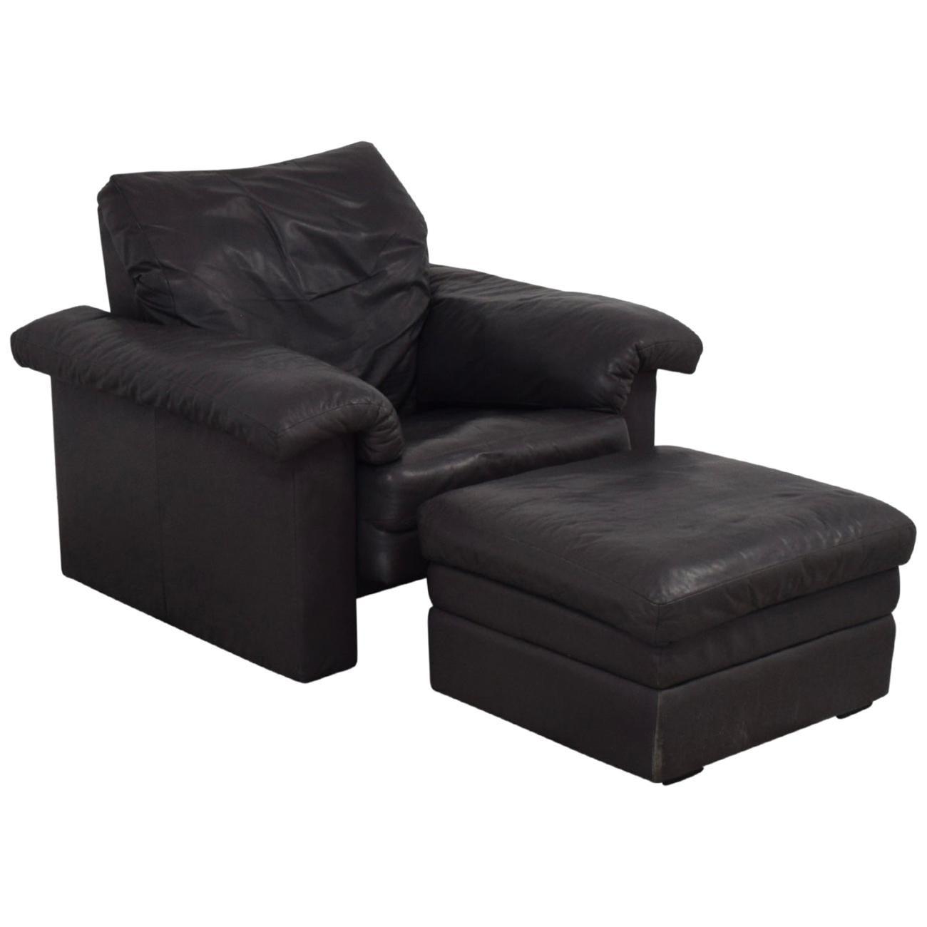 Adjustable Headrest Aubergine Leather Rolf Benz Armchair and Ottoman for Cy Mann