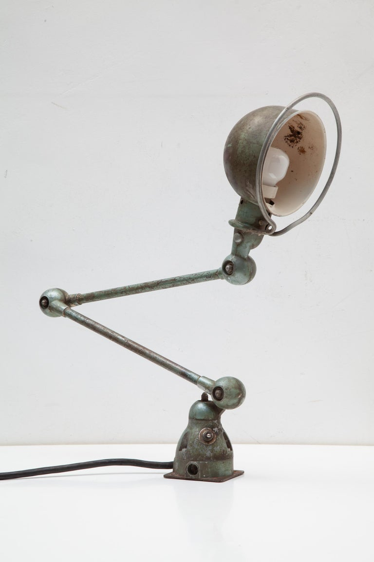 Jieldé is a French brand of industrial lamps made in 1950 by Jean-Louis Domecq (1920-1983).Jean-Louis Domecq started with the design of a special adjustable lamp. This two-arms lamp with a nice vintage patina allows for many articulations also can