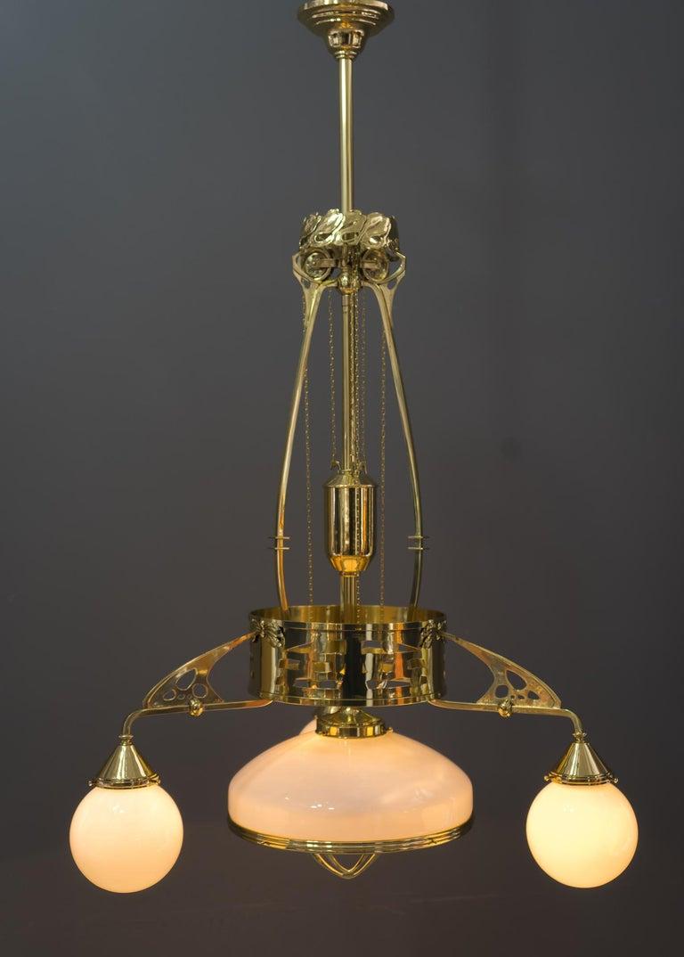 Adjustable Jugendstil chandelier with original opal glasses, Vienna, circa 1910s Polished and stove enameled Original opal glasses Adjustable vrom 125cm-150cm.
