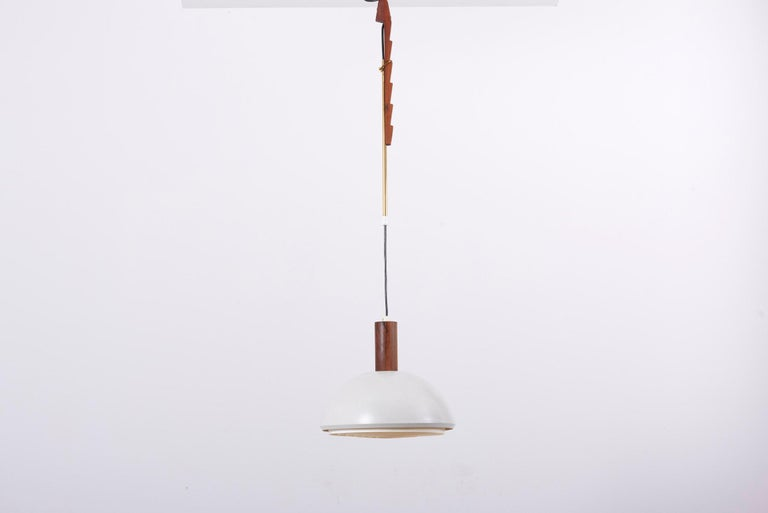 Height adjustable pendant lamp, designed by Svend Aage Holm Sørensen and manufactured by Holm Sørensen and Co in Denmark. Made of teak wood, brass, metal and plastic.  1 x E27 socket.  Please note: Lamp should be fitted professionally in