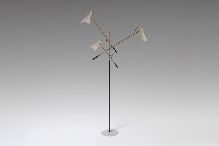Refined floor lamp produced by Stilnovo, Italy, 1950s. This stunning large floor lamp has three adjustable arms connected to the central brass stem and stands on a round marble base. The lamp is fully adjustable; the arms as well for the ivory