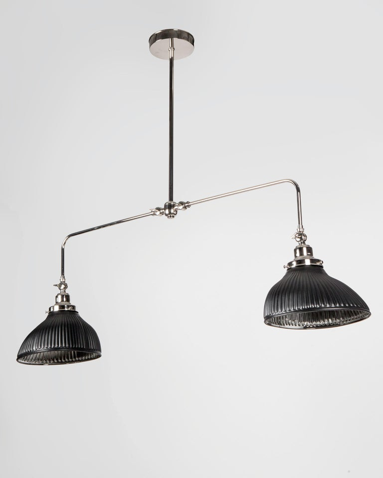 AHL4190 A two arm billiard chandelier with articulating arms, each holding a vintage mercury glass shade from the 1930s. Adjustable at both the cluster and the top of each shade, this solid brass frame was custom made, hand polished, and