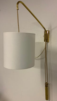 adjustable wall light with counterweight