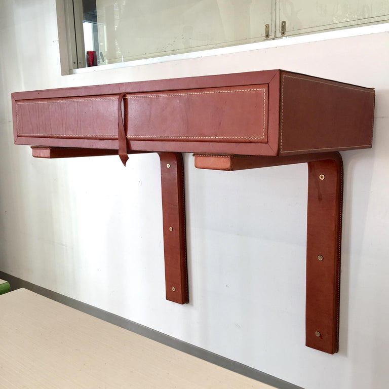 Mid-Century Modern Adnet Style Saddle Stitched Leather Cantilevered Wall Console For Sale