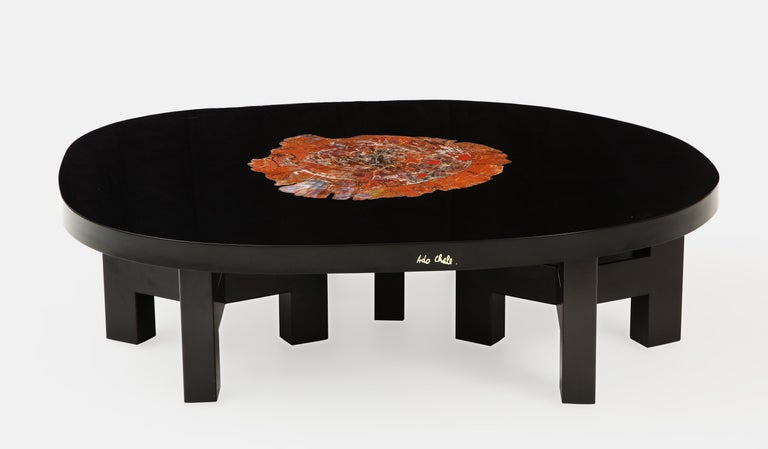 Ado Chale Rare coffee table with Arizona petrified Sequoia wood inlaid in thick lacquered resin tabletop resting on 3 sets of black painted tripod steel brackets. The Sequoia fossilized wood dates back 250 million years and sits in sharp contrast