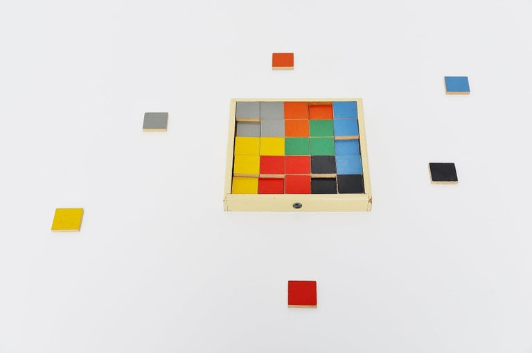 Very rare puzzle tiles box model 259. designed by Ko Verzuu for Ado Holland in 1939. Ado means Arbeid door onvolwaardigen, translated; labor by incapacitated, which makes this an even more special piece. Toys by Ado are being highly collected at the