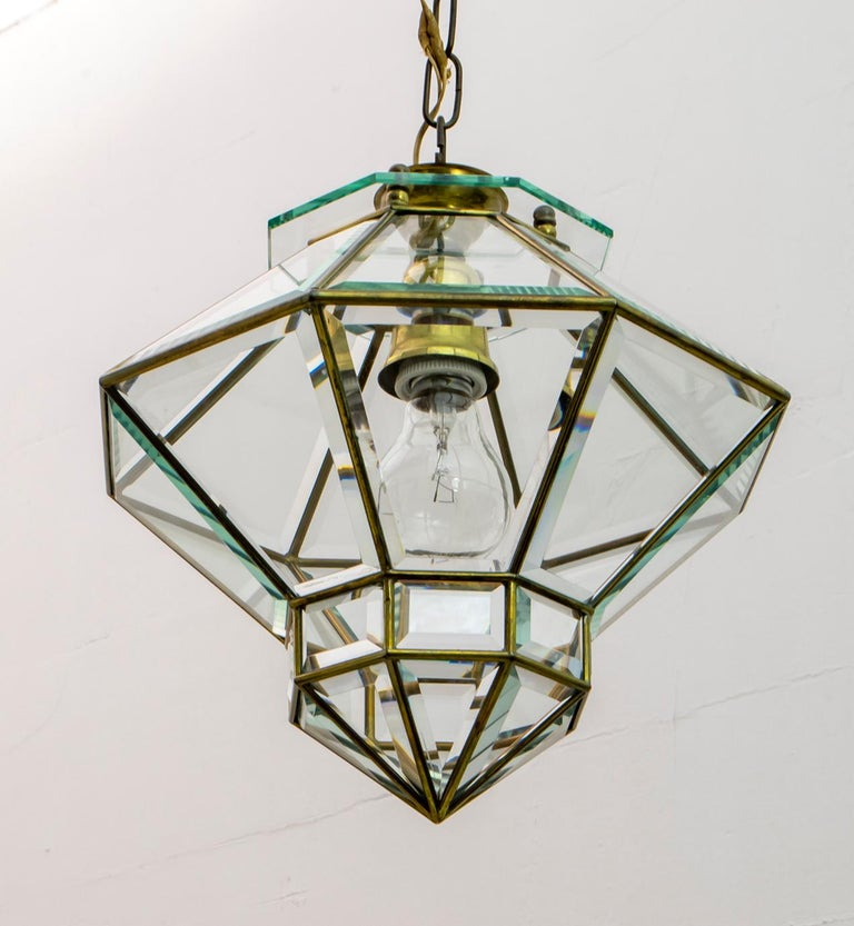 Secessionist Vienna (Sezession, Secessionsstil or Jugendstil) period and style pendant and beveled glass suspension fixture attributed to the Austro-Czech architect and designer Adolf Loos (1870-1933) of octagonal shape with 32 beveled glass panels