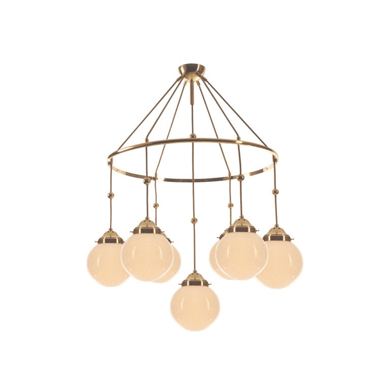 These kind of chandeliers were often used by Adolf Loos in mansions he designed.  All components according to the UL regulations, with an additional charge we will UL-list and label our fixtures.