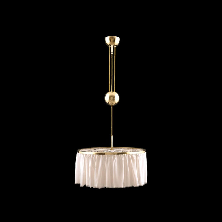 Chandelier in several versions used by both of the architects, the height of the chandelier is to extend with a pulley. The displayed version was used by Adolf Loos for the Stoessel house in Vienna. On the bottom we can mount a diffuser on request,