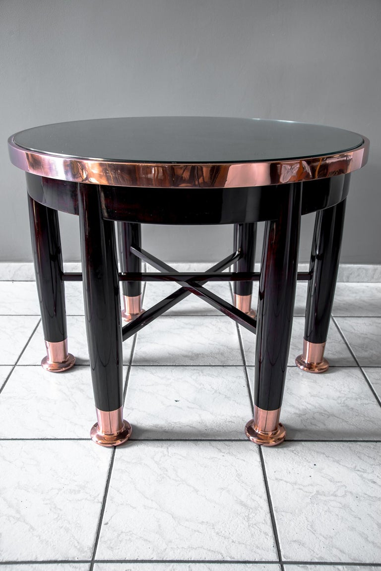 Adolf Loos used this model for the first time in 1899 in the home of Dr. Hugo Haberfeld. Executed by Friedrich Otto Schmidt. Solid mahogany and veneer, legs solid nut, professionally stained and repolished, copper fittings, legs with copper