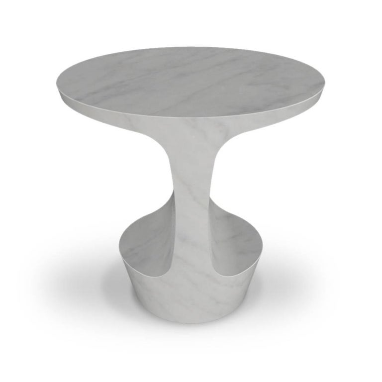Side table designed by Adolfo Abejon.