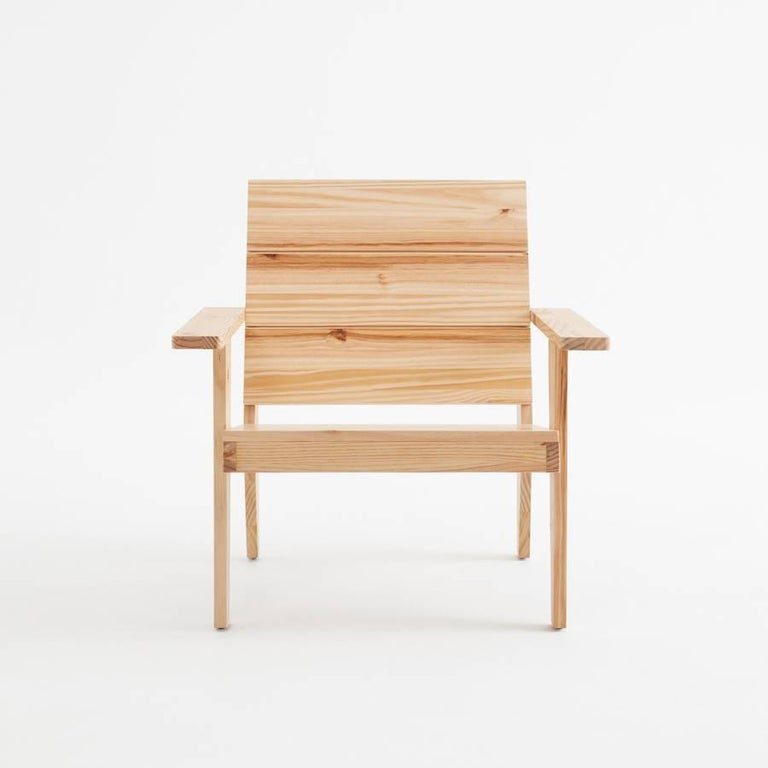 Woody armchair designed by Adolfo Abejon.  Woody is a handmade pinewood patio armchair with a humble soul, a noble mind and reminiscing the Adirondack chair. Woody's back also incorporates a handle to drag it around easily. Available in matt