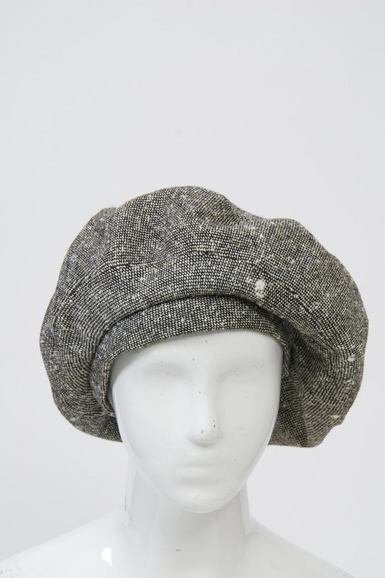 Adolfo full beret in black-and-white tweed wool with seamed construction for fullness and wide headband. Black ribbon ties can be used under chin or tucked away. Lined and in excellent condition. Interior band measures approximately 23