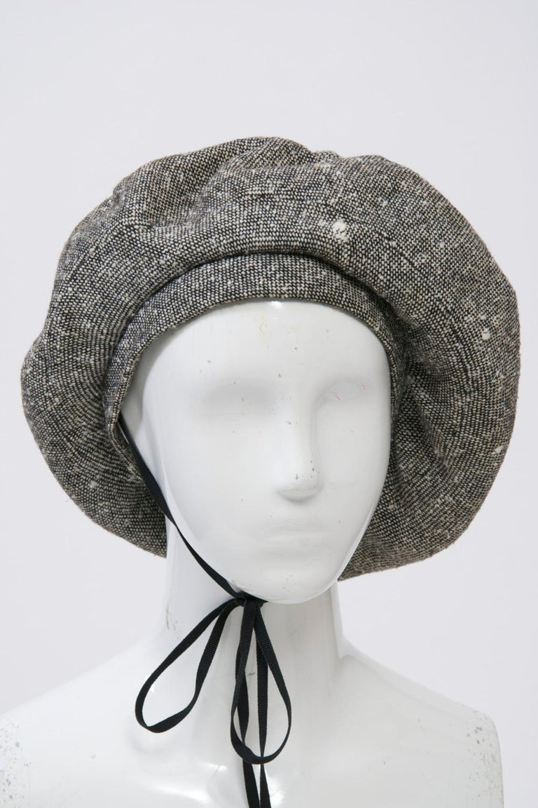 Adolfo large beret in black and white tweed wool, c.1960s-1970s. Black ribbon ties optional for securing hat. Black faille lining. Looks unworn. Interior band measurement approximately 23