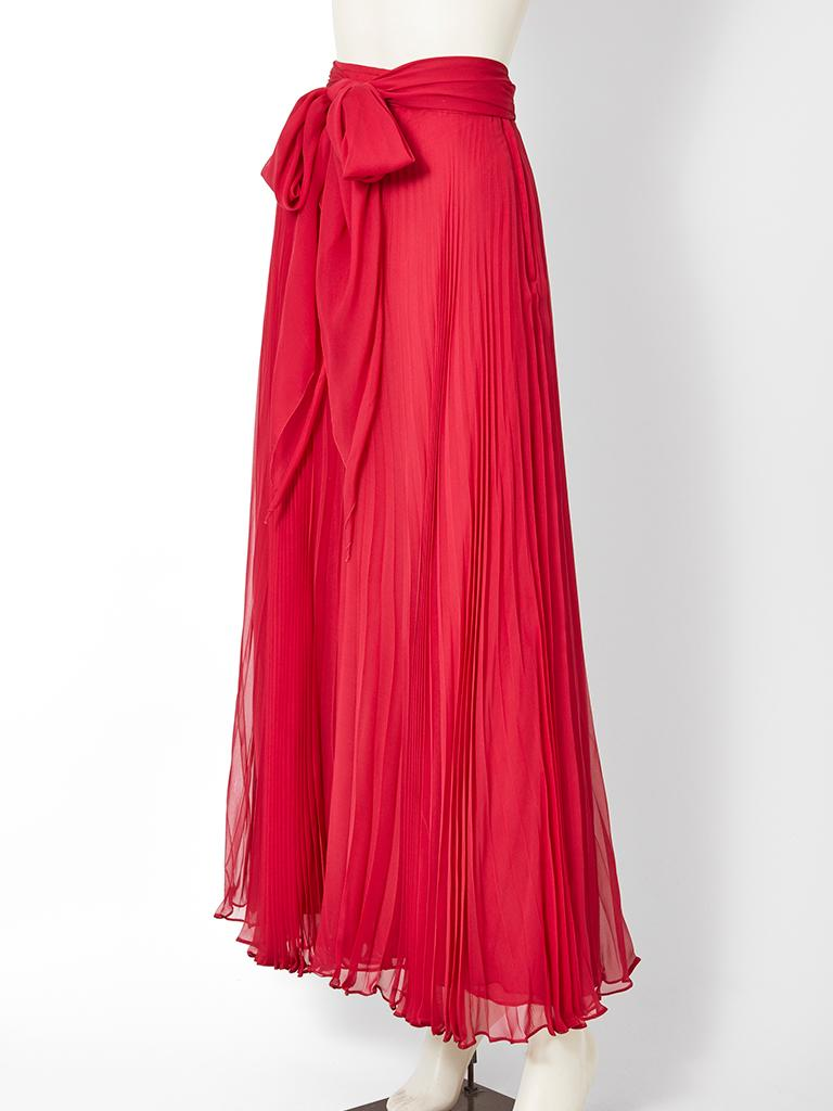 Adolfo, red, chiffon, crystal pleated, bias cut maxi skirt, having a matching self tie at the waist.