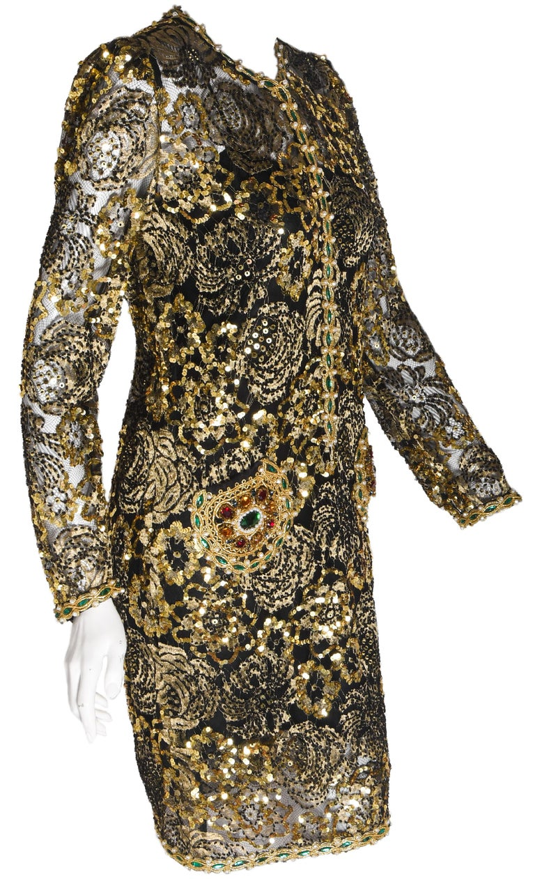Adolfo 1980's vintage beaded gold lace and gold tone lace dress contains faux pearls, beads and sequins in a floral pattern throughout.  Dress, also, includes a beaded gold thread trim around neckline, border of long sleeves and hemline decorated