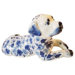 Adorable Reclining Blue and White Porcelain Dog Sculpture