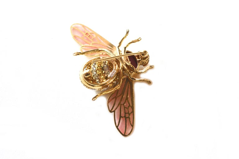 Pink plique-a-jour bee brooch set in 18K gold and platinum rubellite thorax 3.36 ct. Pave white diamonds .7 ct and canary diamond 1.25 ct body. Ruby eyes. About 1.5