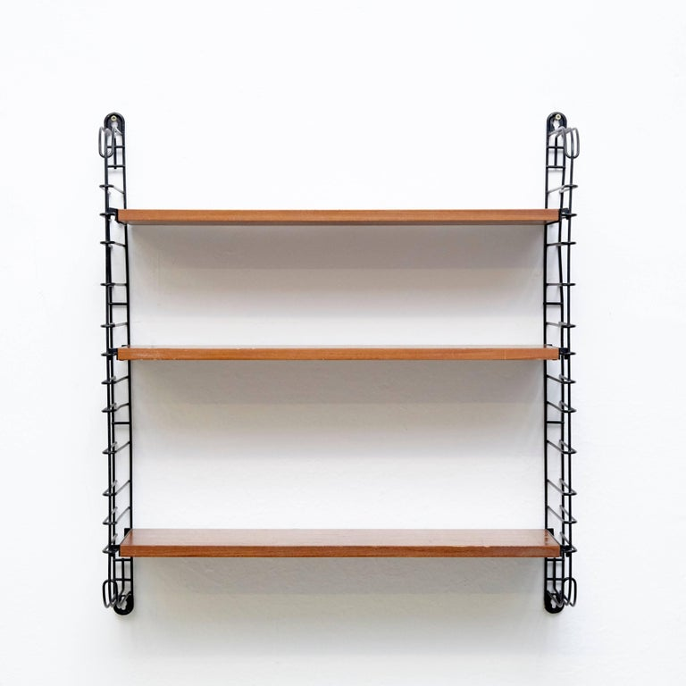Modular shelves designed by Adriaan D. Dekker in 1958. Manufactured by Tomado in the Netherlands.  It possible to fit multiple shelves together, thus achieving a personalized/modular shelving system.  In good original condition with minor wear