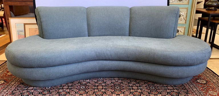 Newly upholstered in a luxurious slate gray cotton blend fabric, this Pearsall seven-foot sofa has the curved silhouette, scale and comfort that make it so coveted.